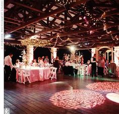 Lighting played a huge role in this wedding: Pink up-lighting ran up the pillars at the venue, while strands of twinkle lights were intertwined in the wood planks of the ceiling. Free Wedding, Our Wedding, Wedding Stuff, Event Lighting, Wedding Lighting, Barn Lighting, Custom Lighting, Lighting Ideas, Pink Wedding Receptions