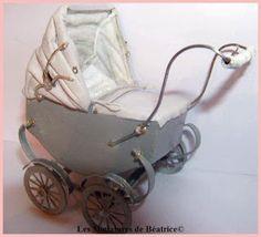 Beatrice: Another miniature pram.
