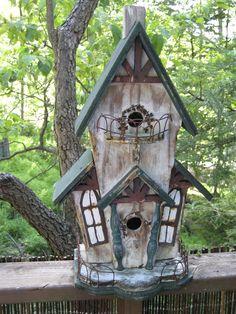 unique birdhouses | love the balcony on this unique birdhouse