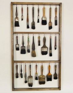 Paint brush storage in empty picture frame