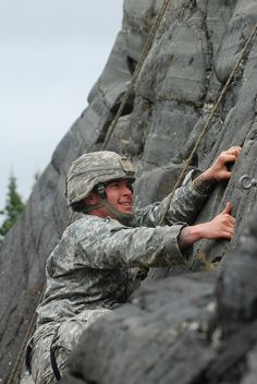 Staff Sgt. Matthew Jackson, 9th Army Band, shows strength and determination in climbing the face of a cliff during the Northern Warfare training Center's Basic Mountaineering Course, July 2012. (U. S. Army photo by Staff Sgt. Trish McMurphy, USARAK Public Affairs)