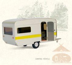 Miniature 1973 Caravan with an opening door so you can peek inside.