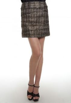 Glitz and glamour ruled the runways this season. Update your wardrobe with the trend in the Metallic tweed skirt by Korean Selection. Let the skirt be the focal point of your outfit - pair with a black leather or black lace top for a shot of modern luxe.