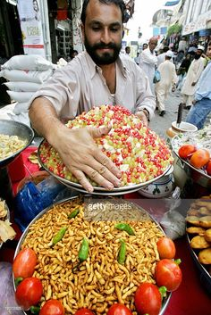 A Pakistani vendor arranges food items at his roadside stall in preparation for Iftar (fast breaking) during Muslim holy month of Ramadan in Islamabad, 02 October 2006. Several people start a temporary side business during Ramadan to supplement their earnings. Practicing Muslims abstain from eating, drinking, smoking and any sexual activities from dawn to dusk during the holy fasting month of Ramadan. AFP PHOTO/Aamir QURESHI .