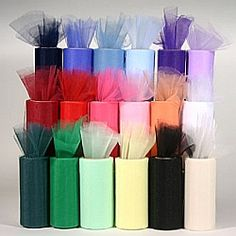 Sheer 6 inch wide tulle fabric rolls in many colors for decorating weddings and parties.  Use economical tulle for wedding decorations and other events.