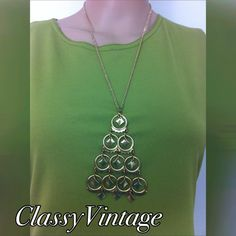 1970's tiered necklace. Tiered gold tone circle shapes with triangles dangling in centers. Super fun - unmarked and 24 inch chain. Vintage Jewelry Necklaces