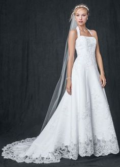 Satin halter A-line gown with beaded lace applique and cut-out-lace hem. Chapel train.    David's Bridal
