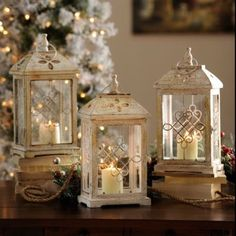Antique Cream Wood Lantern, 16.75 in.   Kirkland's These antique lanterns from Kirklands are really pretty.