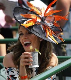 A Race Fans Enjoys Her Mint Juleps Before The Running Of Kentucky Derby At Churchill Downs On May 2015 In Louisville