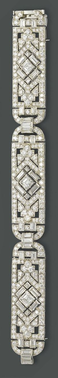 AN ART DECO DIAMOND BRACELET   Of openwork geometric design, the three circular-cut diamond articulated panels, to the baguette and square-shaped diamonds accents, mounted in platinum, circa 1925, 18.8 cm long