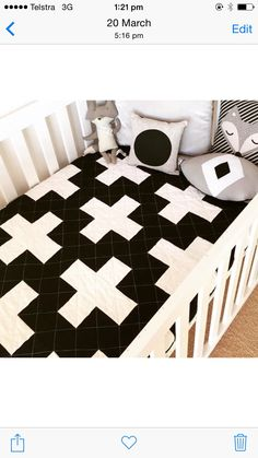 A personal favourite from my Etsy shop https://www.etsy.com/listing/230536330/monochrome-swiss-cross-quilt-cot-size