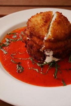 goat cheese stuffed fried green tomatoes with roasted red pepper sauce + basil from SCK in atlanta