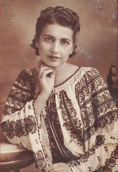Wonderful vintage picture. Traditional costume blouse in cross stitch.