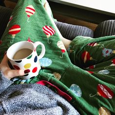 When you work from home and your partner brings you coffee in your favourite mug so you can get the day started in your favourite pajamas. They're the cosiest... no judging that they're clearly Christmas themed #workfromhome #straightchillin #cozyonthecouch #reallife #pajamapants #dreamjob #amwriting www.theradishsociety.com
