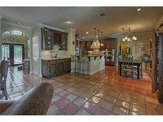 Lovely updated kitchen near the living room for pleasant family time. Saltillo tile floors downstairs.