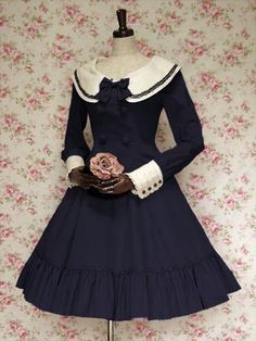 Elegant, classic lolita: Navy dress with white details and collar. Navy bow.