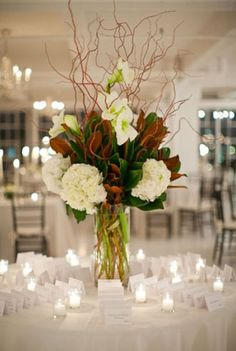 Magnolia leaves, hydrangea, and sticks centerpiece
