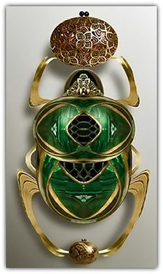 https://www.etsy.com/listing/289992539/jewelry-18k-white-gold-diamond-multi R&Y Augousti | Art Deco emerald, gold scarab brooch.