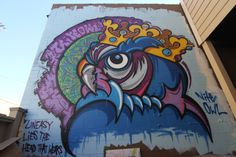 """""""Owl King"""" painted on a wall that Nite Owl regularly curates.The art changes often and many become paintings on canvas or wood!"""