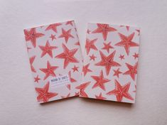 Lovely notebook with illustrated cover with seastars pattern.