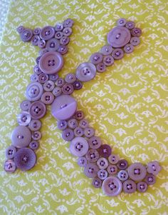 I better start collecting buttons! For Kyah's room. Purple fabric and turquoise buttons maybe...