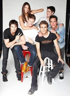 a photo shoot of Elena and all the guys.....  Damon, Matt, Stefan, Tyler and Jeremy