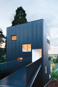 the Tower House by architect Benjamin Waechter. Perched on a steep Cornell Road hillside in Northwest Portland, the four-story house was built up rather than out to minimize foundation costs and to work around the small shelf of a footprint available. Portland Architecture, Architecture Design, Residential Architecture, Amazing Architecture, Contemporary Architecture, Installation Architecture, Industrial Architecture, Landscape Architecture, Modern Contemporary
