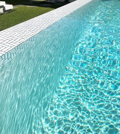 Feature Pool Tiling....I'm obsessed with it. A lovely close up of this white plaster above ground pool with feature tiled infinity edge.…