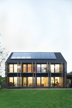 With the roof angled at 43 degrees, the architects lined the southern slant of the house with solar panels to collect as many rays as possible. Photo by Nicholas Calcott. Read more: http://www.dwell.com/slideshows/passive-prog