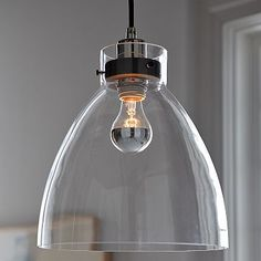 West Elm - I like how the industrial LED light bulb actually suits the look of the fixture. The bulb becomes part of the art.