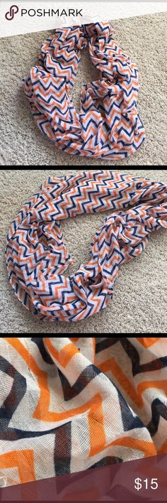 "Super Cute Orange and Navy Chevron Infinity Scarf Great for summer! Lightweight, linen-like material, orange and navy blue chevron over white infinity scarf. 100% polyester, 30""x70"" size and only a few minor pulls, not noticeable at all when you're wearing it. Looks super cute with just about anything, a little sad to be getting rid of it, but I need more space in my closet. Third and fourth pictures are close to actual colors. Please, NO trades and ask any questions before purchasing :)…"