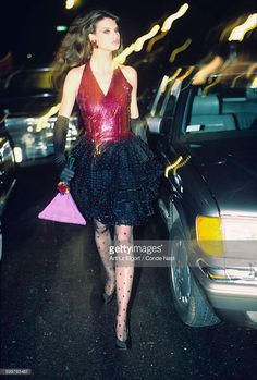 News Photo : Model Linda Evangelista wearing fuchsia sequined...