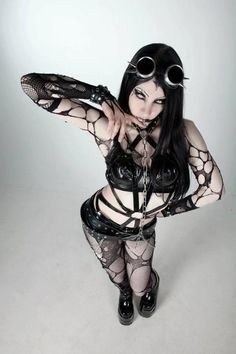 Fishnet #Goth girl looking somewhat fetish and adding a Cyber punk set of goggles