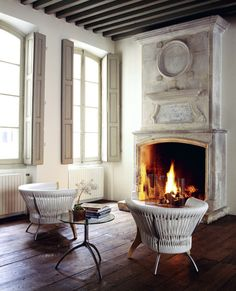 Fireplace  LOVE THIS COLOR OF WHITE ON WALLS  PLUS WHITE FLOOR++++ BRONSON PINCHOT  SHOW+++++