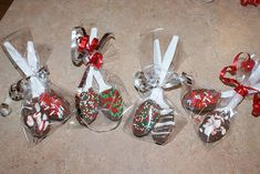 chocolate covered spoons- put in gift set with hot chocolate mix and either pepperment or cinnamon sticks in the center with mug! Awesome!