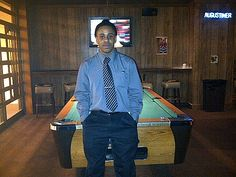 My son Ja'red the day I beat him in pool. He wasn't too happy afterward but he played it off good.