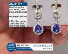 Blue Sapphire Michael Christoff designer earrings.   Item #416-41617 Michael Christoff 5.93 ctw Sapphire Pear & 2.40 ctw Multi Color Diamond Round 18K White Gold Dangle Earrings  Discover Gemstones and stunning jewelry from every era, vintage diamond rings, Art Deco blue sapphire earrings, estate emerald bracelets, ruby necklaces and more! Tune in to Gem Shopping Network to see more stunning Gemstones & Jewelry 24/7.