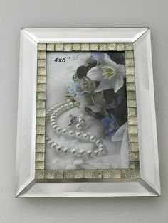 """Mirrored  Photo Frame With Large Crystal Inlay 4 X 6      Features        Photo frame - modern and simple      Great for displaying those special moments and precious memories      Portrait      Fits picture size 4"""" x 6""""  Frame Size: 15.5cm x 20cm    Package Contents        1 x Photo frame      1 x White Box    Only $30.00 plus Shipping World Wide   Shop this product here: http://spreesy.com/itstartedwithagift/32   Shop all of our products at http://spreesy.com/itstartedwithagift…"""