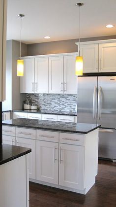 Backsplash and white cabinets Eee! With red small appliances (i.e. toaster, microwave, blender)