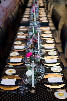 polka dot tablecloth reception - photo by Christie Graham Photography http://ruffledblog.com/glam-wedding-with-a-french-bulldog-theme #weddingideas #tablescape