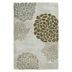 Hand-tufted New Zealand wool rug with a light grey floral motif.   Product: RugConstruction Material: New Zealand woolColor: Light greyFeatures:  Made in IndiaHand-tufted Note: Please be aware that actual colors may vary from those shown on your screen. Accent rugs may also not show the entire pattern that the corresponding area rugs have.Cleaning and Care: Professional cleaning recommended