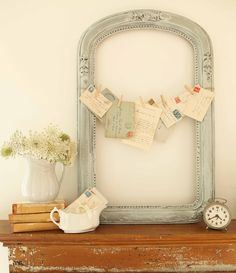 vintage frame + jute twine + old letters from France = my new mantel display!