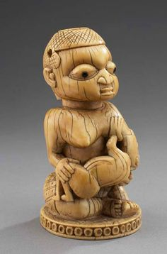 Mother and Child Yoruba artist of the Owo Kingdom, Nigeria 1500s or 1600s ivory