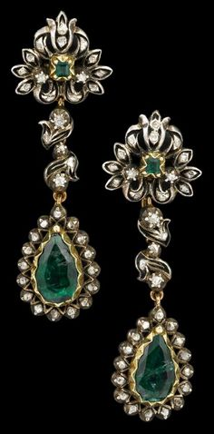 Silver topped yellow gold, emerald and diamond earrings   georgian   Pendant style earrings displaying pear shaped emerald accented by petite rose cut diamonds.