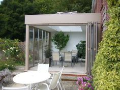 Steel and aluminium framed extension, with folding sliding doors
