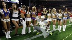 Houston Texans' J.J. Watt poses with the Pro Bowl cheerleaders after Team Irvin defeated Team Carter 32-28 in the NFL Football Pro Bowl Sunday, Jan. 25, 2015, in Glendale, Ariz. (AP Photo/David J. Phillip)