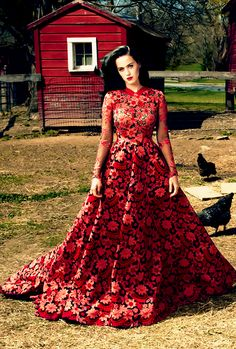 Katy Perry in July 2013 Vogue, wearing red lace Valentino Haute Couture gown