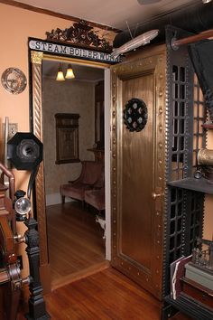 I wasn't planning on doing anything to my office door, but now I just might have to. Hell, it's already metal. Casa Steampunk, Steampunk Interior, Steampunk Kitchen, Steampunk Bedroom, Steampunk Desk, Steampunk Home Decor, Mode Steampunk, Steampunk Furniture, Steampunk Fashion