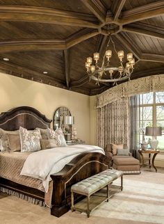 This master bedroom is simple and spectacular! The ceiling makes this room pop! Also the rich warm colors make it so welcoming!