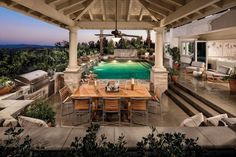 It doesn't get more dreamy than a lively pool, indulgent outdoor kitchen and enough seating for all your friends to join! This Toll Brothers space is made complete with a ceiling fan to ensure guests are staying cool and comfortable in the summer heat.
